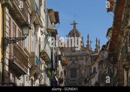 A church dominates a narrow street in the old town, Oporto, Portugal, Europe - Stock Photo