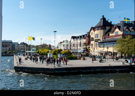 The town of Vaxholm in the Stockholm archipelago as seen from the sea with the Waxholm Hotel in the center - Stock Photo