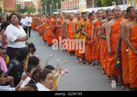 Monks in mourning parade for the late King Sihanouk outside Royal Palace, Phnom Penh, Cambodia, Indochina, Southeast - Stock Photo