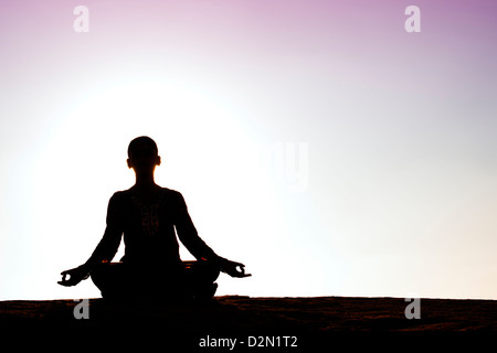 Silhouette of an Indian girl meditating. Andhra Pradesh, India - Stock Photo