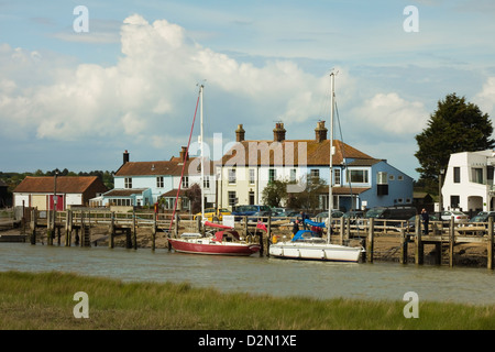 Looking across River Blyth towards houses and moored yachts on the Southwold bank, Walberswick, Suffolk, England, - Stock Photo