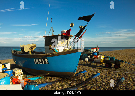 Fishing boat and nets on the seafront shingle beach of this popular unspoiled seaside town, Aldeburgh, Suffolk, - Stock Photo
