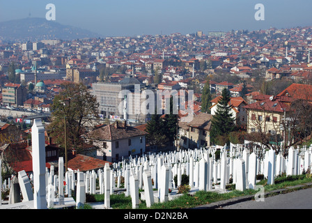 War graves overlooking the National Library which was destroyed during the war. It is being restored with donations - Stock Photo