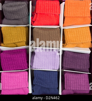 box of colored socks in cells - Stock Photo