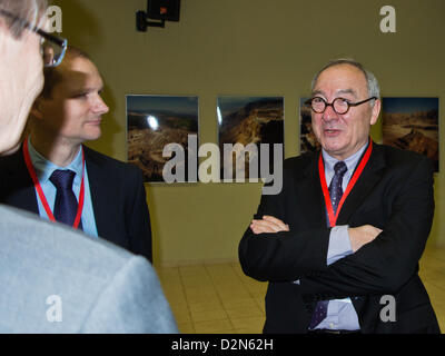 Jean-Jacques Dordain, Director General of the European Space Agency (right), speaks to colleagues at a reception - Stock Photo