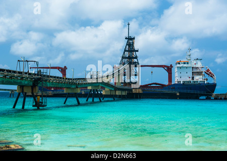 Freighter being loaded with salt in Bonaire, ABC Islands, Netherlands Antilles, Caribbean, Central America - Stock Photo