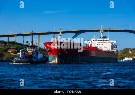 Freighter passing the Sint Annabaai in Willemstad, Curacao, ABC Islands, Netherlands Antilles, West Indies, Caribbean - Stock Photo
