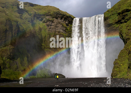 Skogafoss waterfall with rainbow in summer sunshine, South coast, Iceland, Polar Regions - Stock Photo