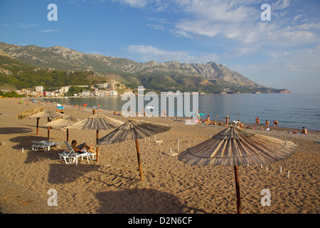 Beach and sunshades, Becici, Budva Bay, Montenegro, Europe - Stock Photo