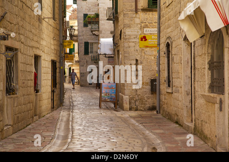Narrow street in Old Town, UNESCO World Heritage Site, Kotor, Montenegro, Europe - Stock Photo