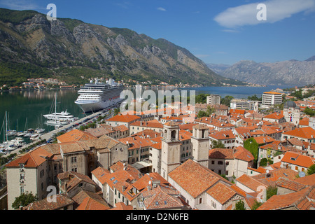 View over Old Town, UNESCO World Heritage Site, with cruise ship in port, Kotor, Montenegro, Europe - Stock Photo