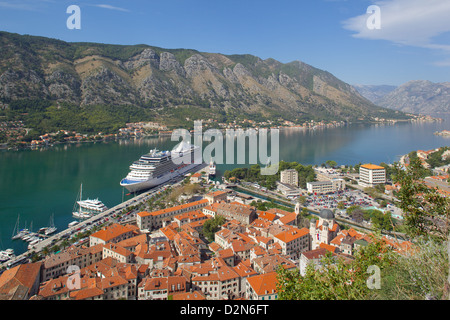 View over Old Town and cruise ship in Port, Kotor, UNESCO World Heritage Site, Montenegro, Europe - Stock Photo