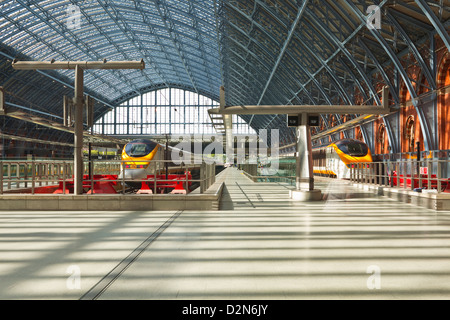 Two Eurostar trains await departure at St. Pancras International, London, England, United Kingdom, Europe - Stock Photo