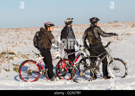 Mountain bikers in snow at Roseberry common near Roseberry Topping near Great Ayton, North York Moors National Park, - Stock Photo