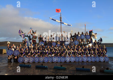 Shetland, Scotland, UK. Tuesday 29 January 2013.  The guizer jarl (chief viking) and his squad in the galley during - Stock Photo