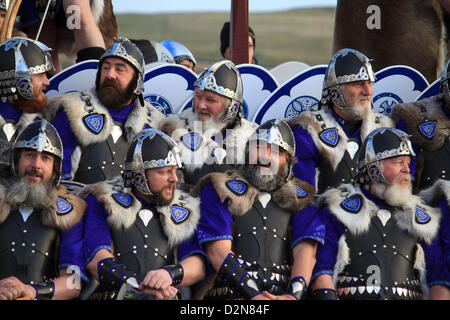 Shetland, Scotland, UK. Tuesday 29 January 2013.  Members of the guizer jarl (chief viking) squad in full suit during - Stock Photo