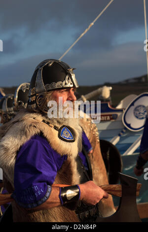 Shetland, Scotland, UK. Tuesday 29 January 2013.  One of the guizer jarl (chief viking) squad in full suit during - Stock Photo