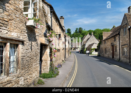 Picturesque village of main street in Castle Combe in the Cotswolds, England taken on a fine summers day in summers - Stock Photo