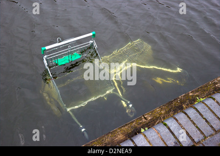 Shopping Trolleys dumped in canal by vandals - Stock Photo