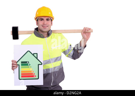 Construction worker with an energy rating card - Stock Photo