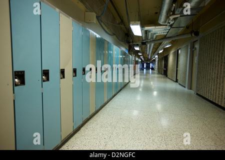row of locked school lockers in empty corridor of High school canada north america - Stock Photo