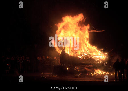 Shetland, Scotland, UK. Tuesday 29 January 2013. The ritual burning of the galley for Up Helly Aa, the Viking fire - Stock Photo