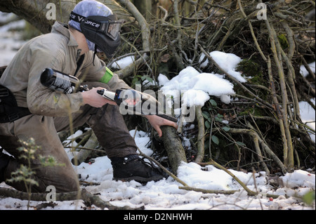 Paintball player in the snow - Stock Photo