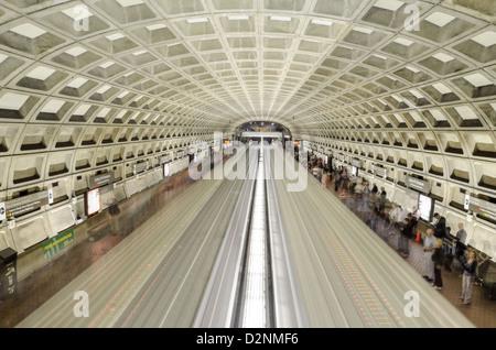 Two trains passing through Chinatown/Gallery Pl metro station in Washington DC - Stock Photo