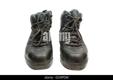 Black leather boots used antique white background. - Stock Photo