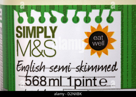 label on 1 pint of Simply M&S English semi skimmed milk - Stock Photo