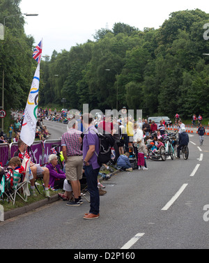 A crowd awaits competitors in the London 2012 Olympics Mens Cycling Time Trial. - Stock Photo