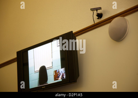 Video link up technology in a court room. - Stock Photo