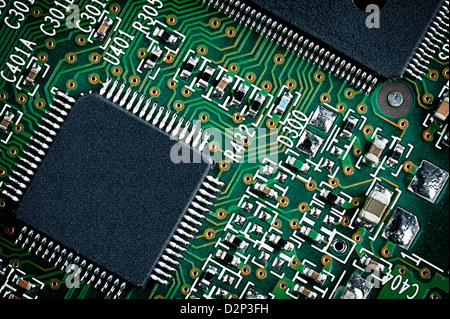 Microchip on green printed circuit board pcb. Close up macro detail. - Stock Photo