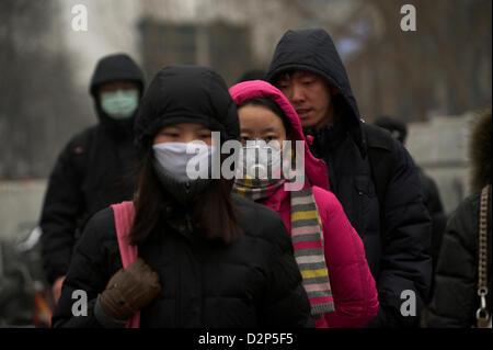 Pedestrians wear the masks in thick haze in Beijing,  China. 30-Jan-2013 - Stock Photo