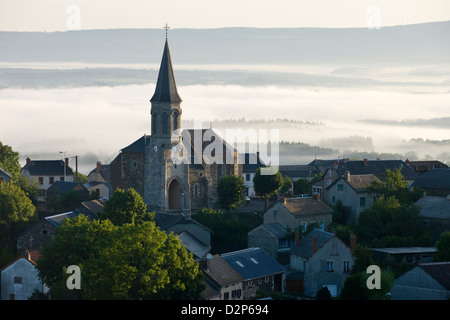 EARLY MORNING MIST OVER VALLEY BELOW FAVEROLLES HILLTOP VILLAGE MARGERIDE TRUYERE CANTAL AUVERGNE FRANCE - Stock Photo