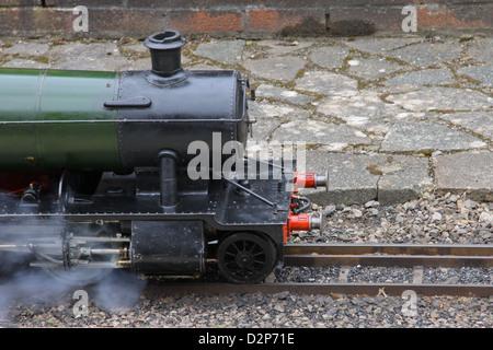 Miniature 2-8-0 steam locomotive - Stock Photo