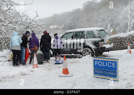 A Range Rover which hit a stationary Vauxhall after sliding in snow forcing it into gardens below on a hill known - Stock Photo