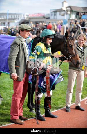 A winning horse and young jockey pose for pictures in the winners enclosure at a childrens meeting at Cheltenham - Stock Photo