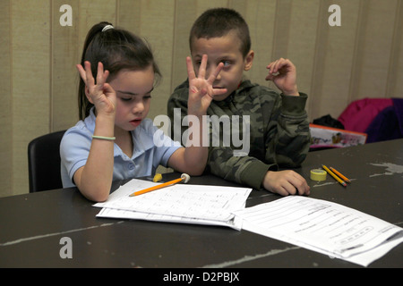 Children participate in an after school homework & education program on the Lower East Side, NYC - Stock Photo