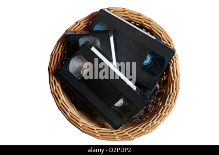 Video tape cassettes thrown away in a waste paper basket. - Stock Photo