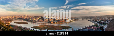 Wide panoramic view of Golden Horn with Halic Bridge, minarets, mosques, Galata tower, Eyup cable car from Pierre - Stock Photo