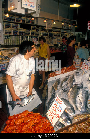 fish vendor, selling fresh fish, fresh fish, Pike Place Market, city of Seattle, Washington, United States - Stock Photo