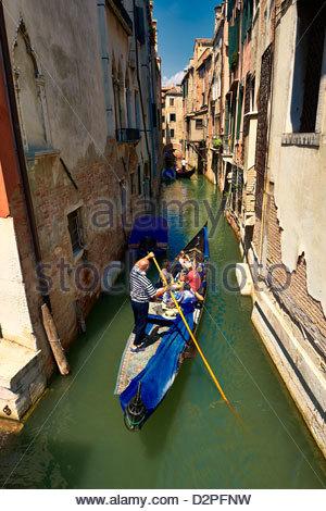 Tourists taking a Gondolas ride   , Venice, Italy - Stock Photo