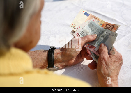Berlin, Germany, a pensioner holds banknotes in his hand - Stock Photo