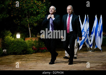 Incumbent Minister of Finance in outgoing government, Yuval Steinitz (L), representing Likud-Beitenu, is escorted - Stock Photo