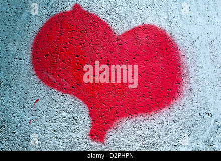 Heart symbol spray painted on a concrete bracelet - Stock Photo