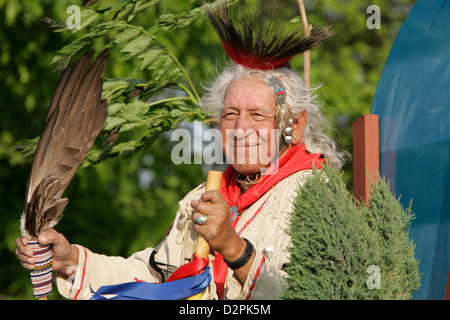 An American Indian Chief smiles in the sun - Stock Photo