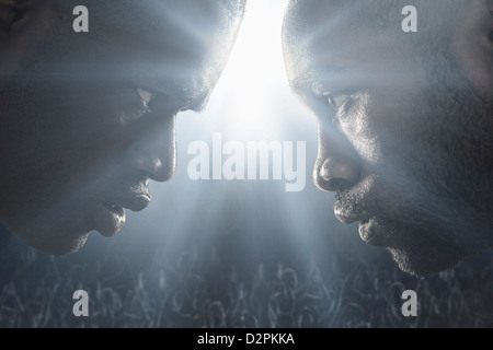 African American boxers standing face to face - Stock Photo