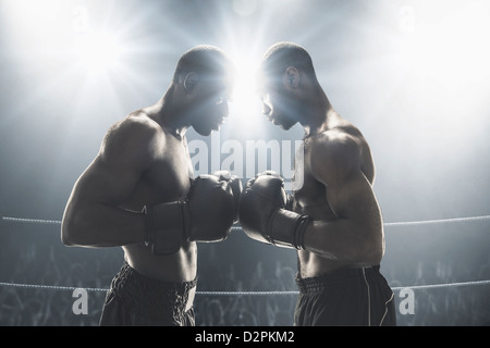 African American boxers standing in boxing ring - Stock Photo