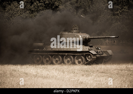 Damaged Soviet tank is covered with dark smoke - reenactment of World War II fights near river Hron on July 7, 2009 - Stock Photo